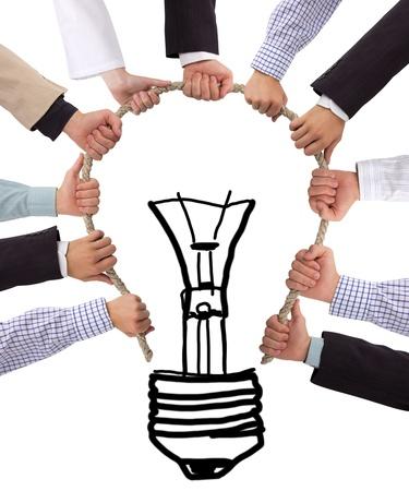 kommunikation: Birne aus Seil mit den Händen Lizenzfreie Bilder