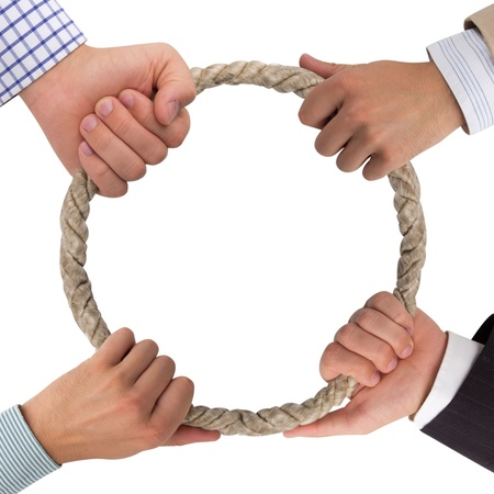 Hands holding rope forming a circle Stock Photo - 14738836