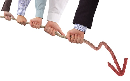 downturn: Hands holding rope with red arrow, concept of crisis Stock Photo