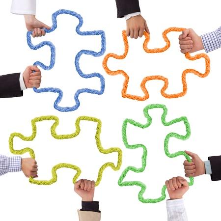Hände halten Formungseinrichtung Puzzle Standard-Bild - 14738802