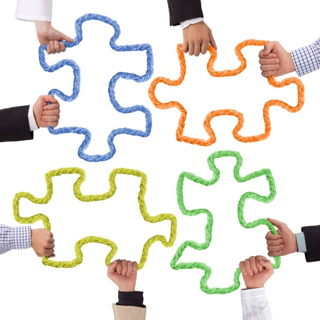 support team: Hands holding rope forming puzzle Stock Photo