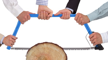 Hands holding saw cutting wood, teamwork concept photo