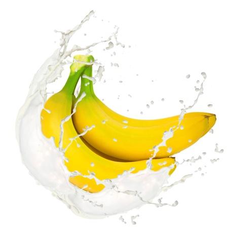 banane: Milk splash � la banane isol� sur blanc