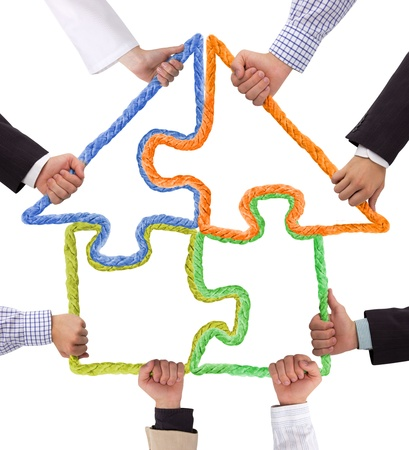 new solution: Hands holding puzzle, house concept Stock Photo