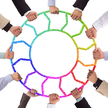 Hands holding colorful rope foming circle
