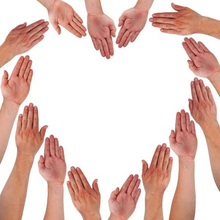 amistad: Manos que forman el coraz�n aislado en blanco Foto de archivo