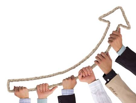 business relationship: Hands holding rope forming arrow pointing upwards Stock Photo