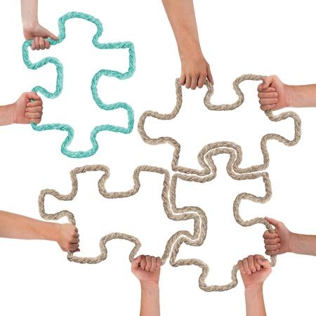 手カラフルなパズルのピース
