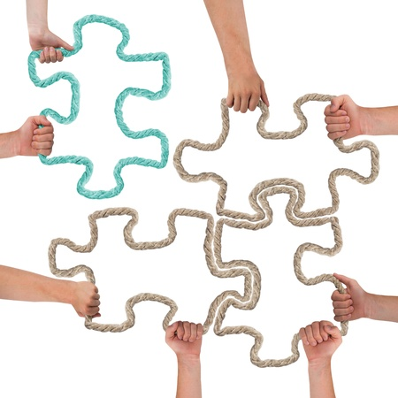 attaching: Hands holding colorful puzzle pieces