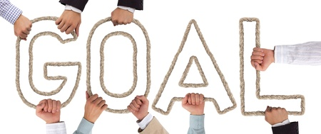 Hands holding letters forming Goal tag Stock Photo - 15635982