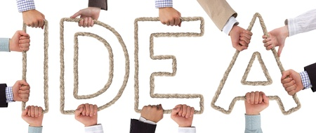 Hands holding letters forming Idea tag Stock Photo - 15636013