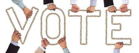 Hands holding letters forming VOTE tag Stock Photo - 15636036