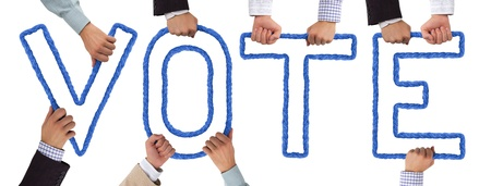 Hands holding letters forming VOTE tag Banque d'images