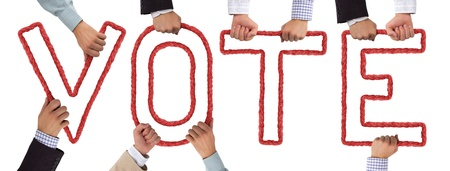 Hands holding letters forming VOTE tag Stock Photo - 15636038