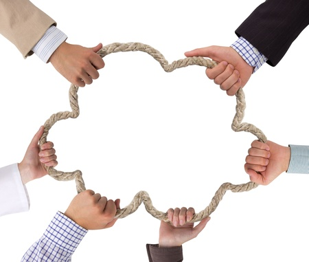 Business hands holding rope forming cloud