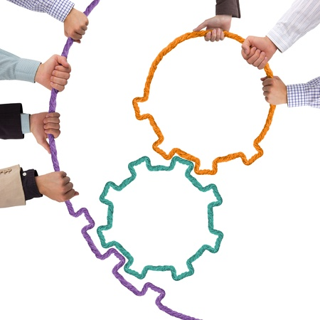 Hands holding toothwheels, teamwork concept Stock Photo