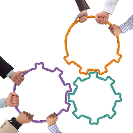 strength in unity: Hands holding toothwheels, teamwork concept Stock Photo