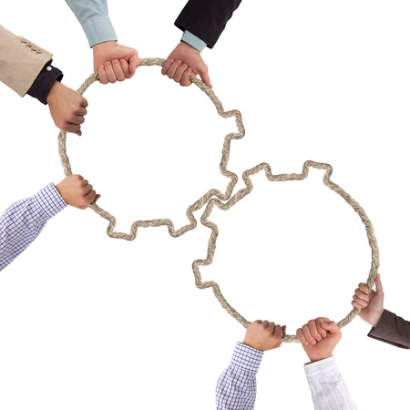 Hands holding toothwheels, teamwork concept Banque d'images