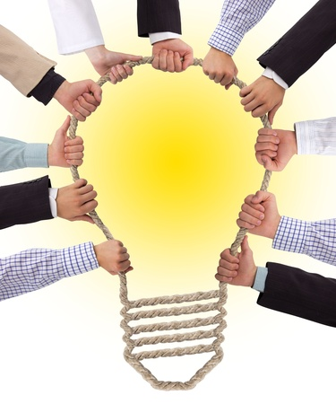 glowing light bulb: Business hands holding rope forming bulb