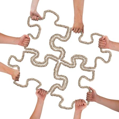 Handen die raadsel op wit wordt geïsoleerd Stockfoto