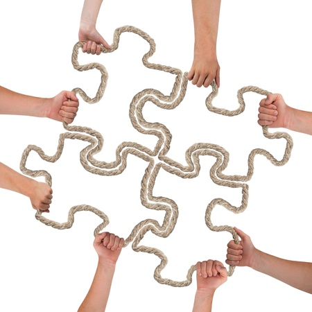 Hands holding puzzle isolated on white photo