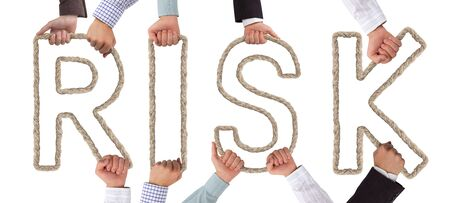 Hands holding letters forming RISK tag Stock Photo - 16035073