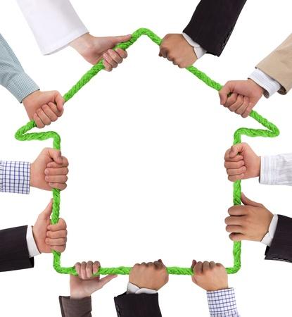 Handen bedrijf touw vormen huis Stockfoto