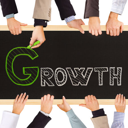 Photo of business hands holding blackboard and writing GROWTH concept photo