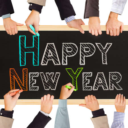 annual events: business hands holding blackboard and writing HAPPY NEW YEAR
