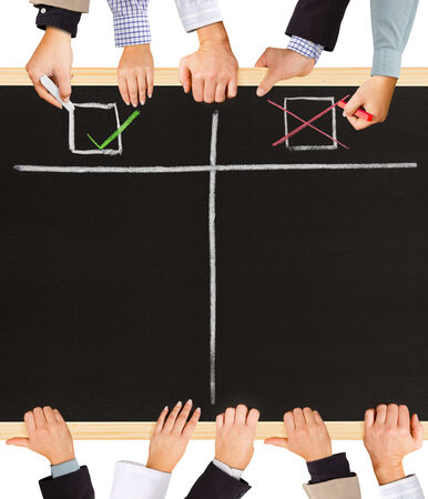 Photo of business hands holding blackboard and writing Positive and Negative symbols photo