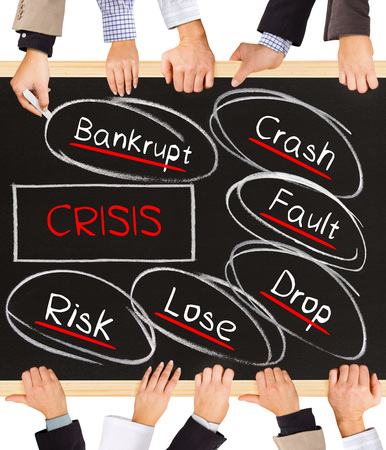 find fault: Photo of business hands holding blackboard and writing Crisis schema Stock Photo
