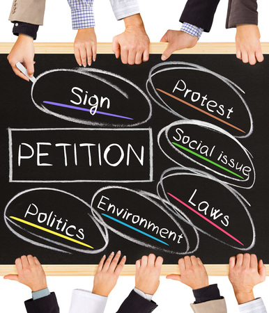 Photo Of Business Hands Holding Blackboard And Writing Petition