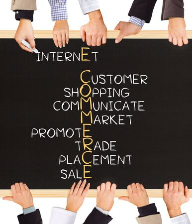 ecommerce: Photo of business hands holding blackboard and writing E-COMMERCE concept Stock Photo
