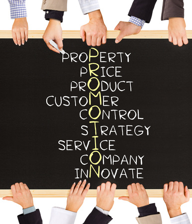 facilitate: Photo of business hands holding blackboard and writing PROMOTION concept Stock Photo
