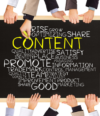 content writing: Photo of business hands holding blackboard and writing CONTENT word cloud Stock Photo