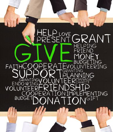 charitable: Photo of business hands holding blackboard and writing GIVE concept