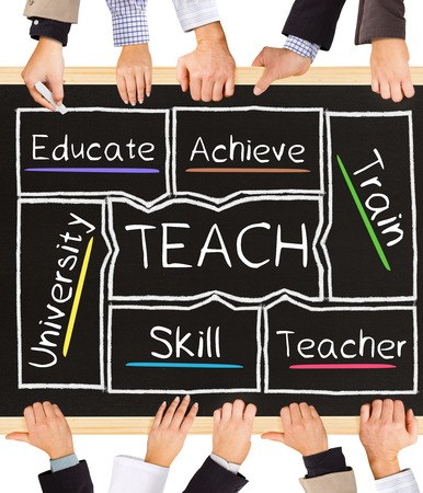 Photo of business hands holding blackboard and writing TEACH diagram