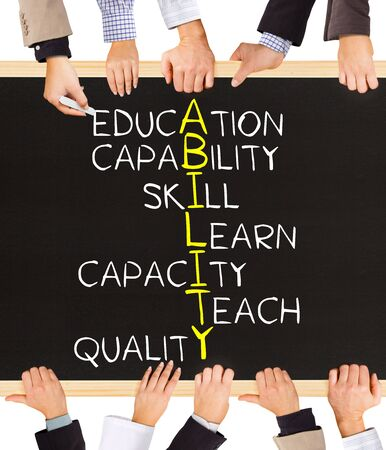 Photo of business hands holding blackboard and writing ABILITY concept Stock Photo