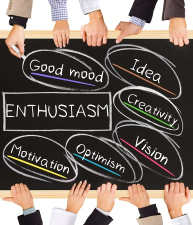 enthusiasm: Photo of business hands holding blackboard and writing ENTHUSIASM diagram Stock Photo