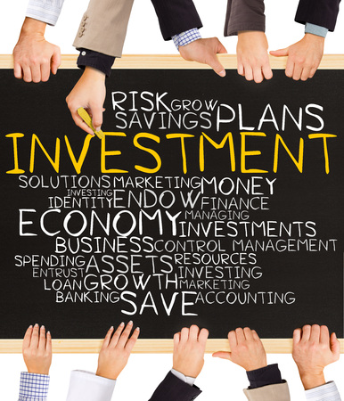 word cloud: Photo of business hands holding blackboard and writing INVESTMENT word cloud Stock Photo