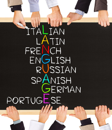 Photo of business hands holding blackboard and writing LANGUAGE diagram Banque d'images
