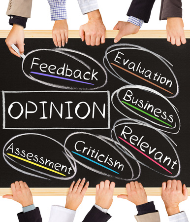 opinionated: Photo of business hands holding blackboard and writing OPINION diagram
