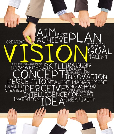 future vision: Photo of business hands holding blackboard and writing VISION concept