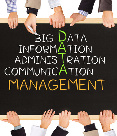 data management: Photo of business hands holding blackboard and writing DATA management concept Stock Photo