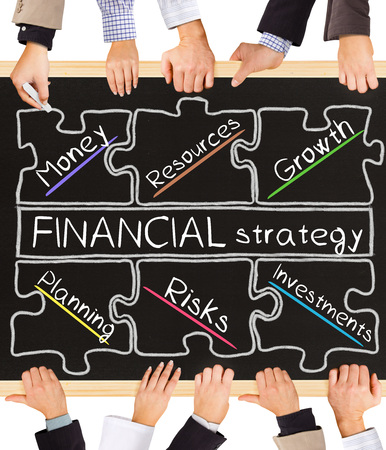 basic scheme: Photo of business hands holding blackboard and writing E-FINANCIAL strategy diagram