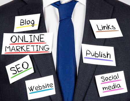 digital media: Photo of business suit and tie with ONLINE MARKETING concept paper cards