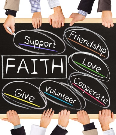 giving back: Photo of business hands holding blackboard and writing FAITH diagram Stock Photo