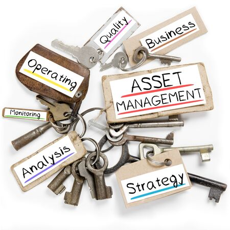 operating key: Photo of key bunch and paper tags with ASSET MANAGEMENT conceptual words Stock Photo