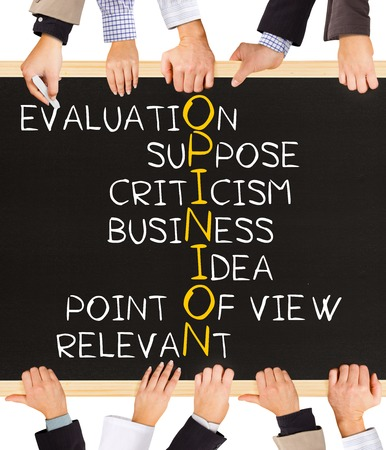 Photo of business hands holding blackboard and writing OPINION concept Stock Photo