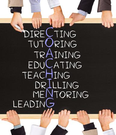Foto von Business-Hände halten Tafel und schreiben COACHING-Konzept Standard-Bild - 46610376